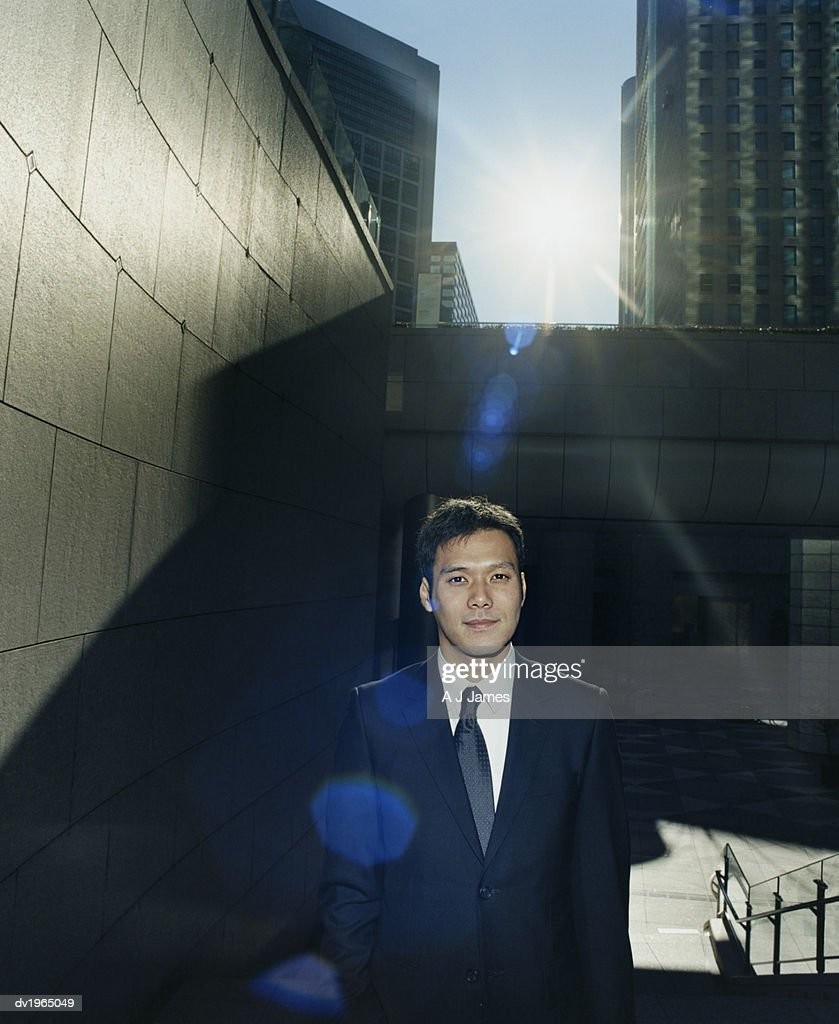 Businessman Standing by a Pedestrian Subway : Stock Photo