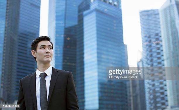 Businessman standing in front of city skyline.