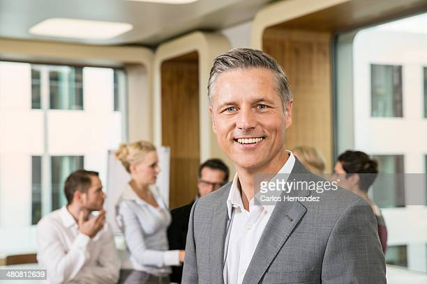 Businessman standing in front of colleagues