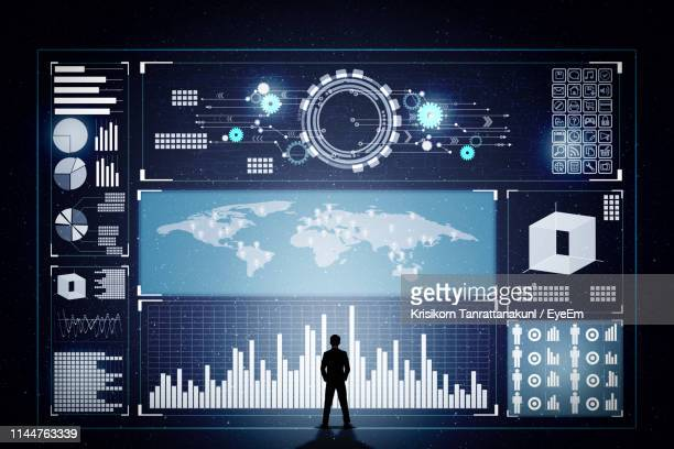 businessman standing in front of hologram - data visualization stock pictures, royalty-free photos & images