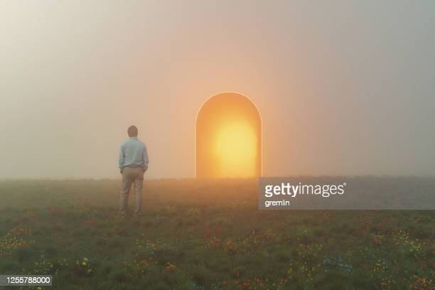 businessman standing in front of mysterious passage - light at the end of the tunnel stock pictures, royalty-free photos & images