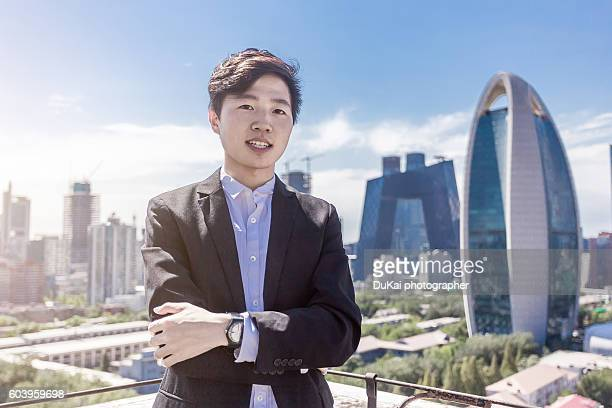 Businessman standing in front of office building