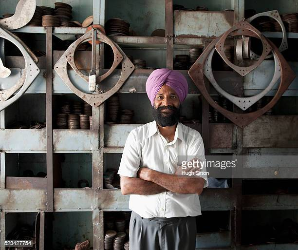 Businessman standing in metal cutting shop