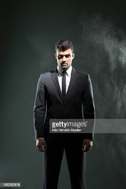 Businessman standing in smoky room