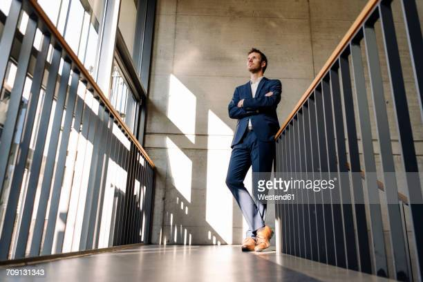 businessman standing in staircase - low angle view stock pictures, royalty-free photos & images