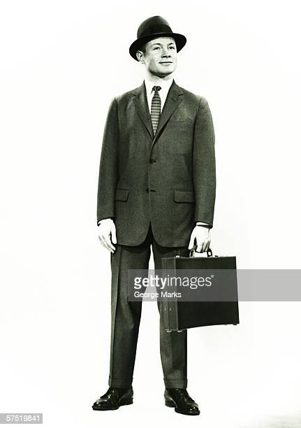 businessman standing in studio, (b&w), portrait - 20th century stock pictures, royalty-free photos & images