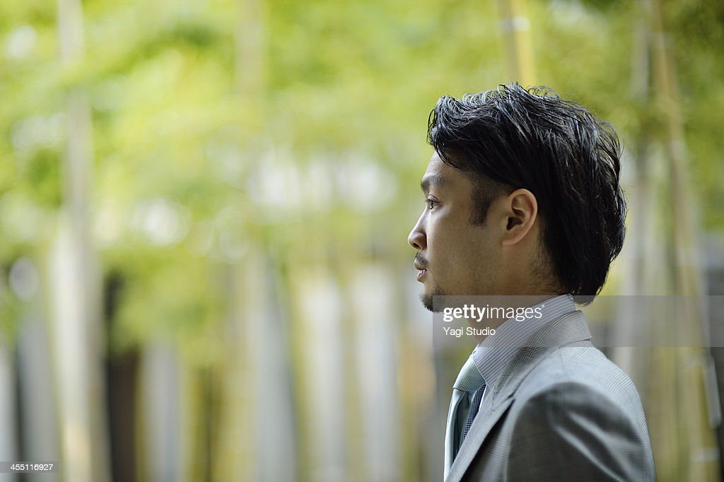 Businessman standing in the city : ストックフォト