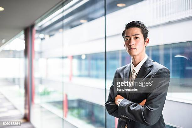businessman standing in the office corridor