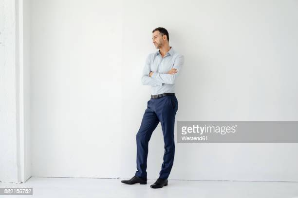 businessman standing looking sideways - leaning stock pictures, royalty-free photos & images