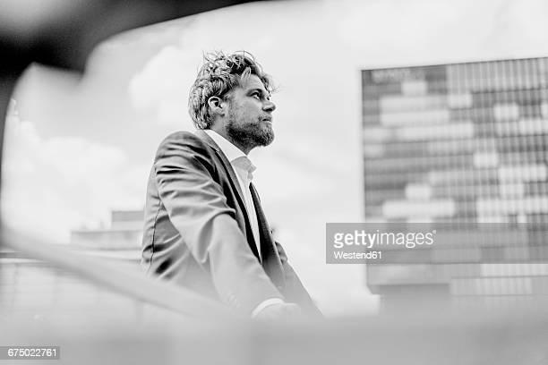 Businessman standing on bridge