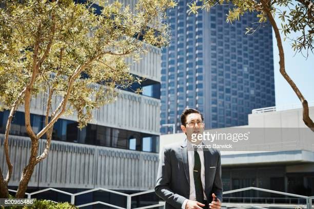 Businessman standing on deck of office building