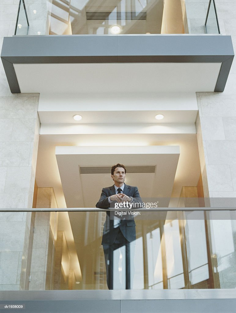 Businessman Standing on the Balcony of an Office Building and Looking at the View : Stock Photo