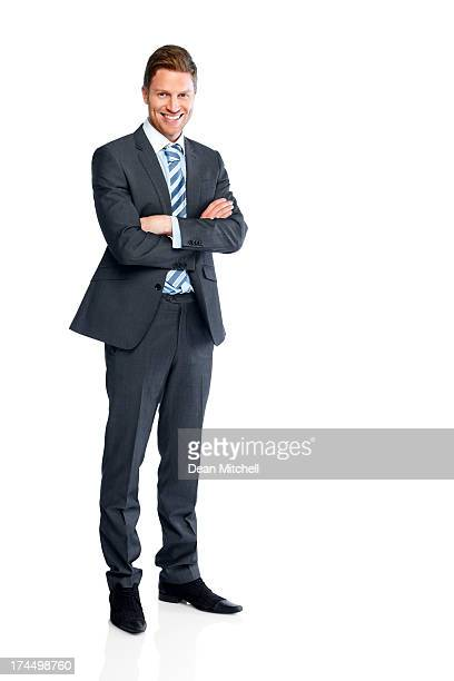 businessman standing with his arms folded on white - mannen stockfoto's en -beelden