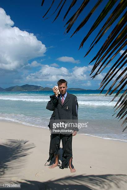 Businessman Stands Tropical Beach Talking on Shellphone