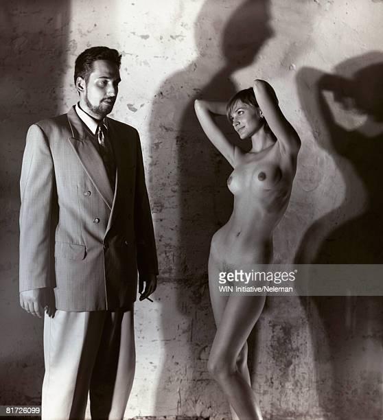 businessman staring at nude woman (b&w) - schamhaar stock-fotos und bilder