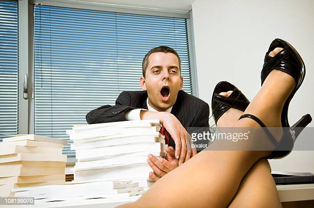 businessman staring at woman's legs - fetish wear stock photos and pictures