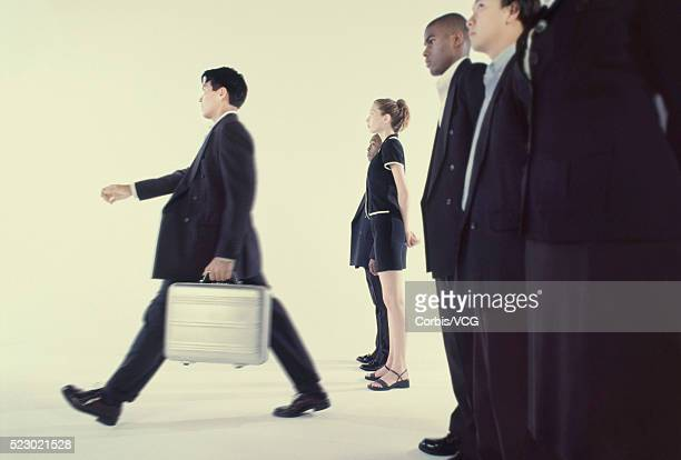 businessman stepping ahead of others - category:cs1_maint:_others stock pictures, royalty-free photos & images