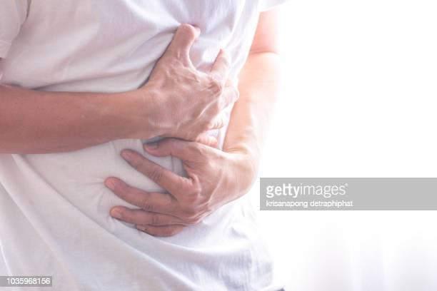 businessman stomachache - apendice inflamado fotografías e imágenes de stock