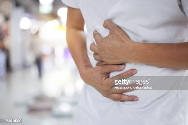 businessman stomachache - appendicitis stock photos and pictures