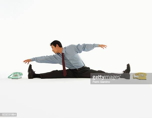 Businessman Stretching for Telephone