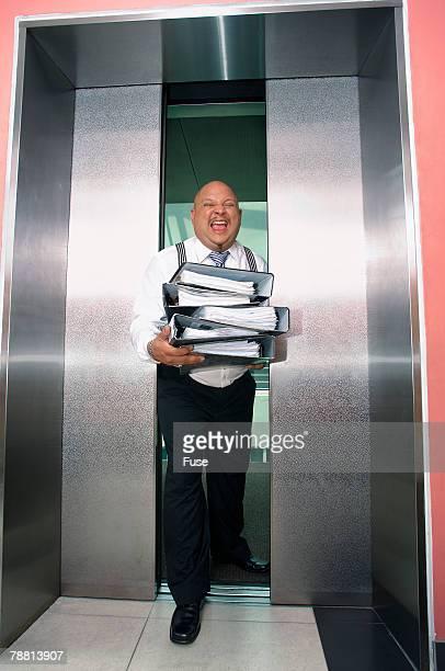 Businessman Stuck in Elevator Doors
