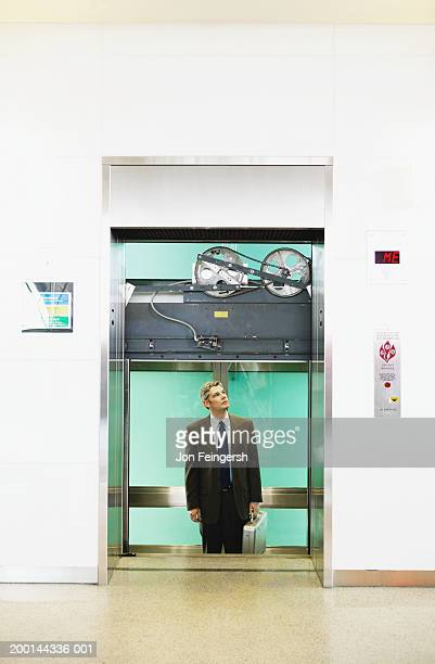 businessman stuck in elevator - trapped stock pictures, royalty-free photos & images