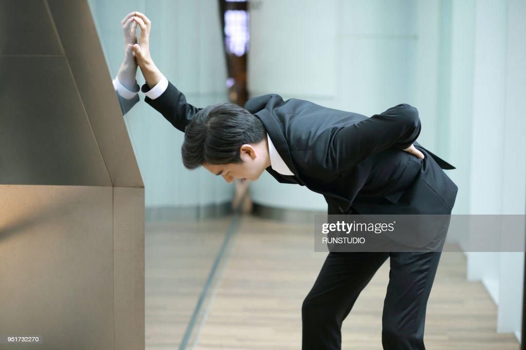 Businessman suffering from backache : ストックフォト