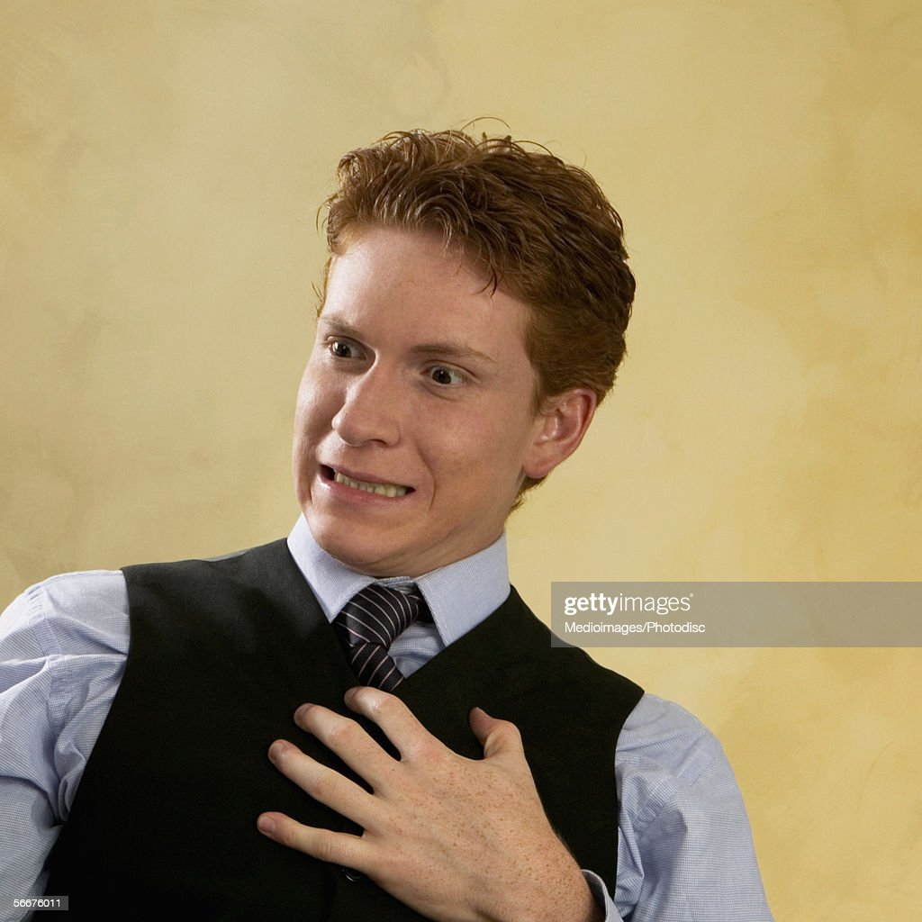Businessman suffering from chest pain : Stock Photo