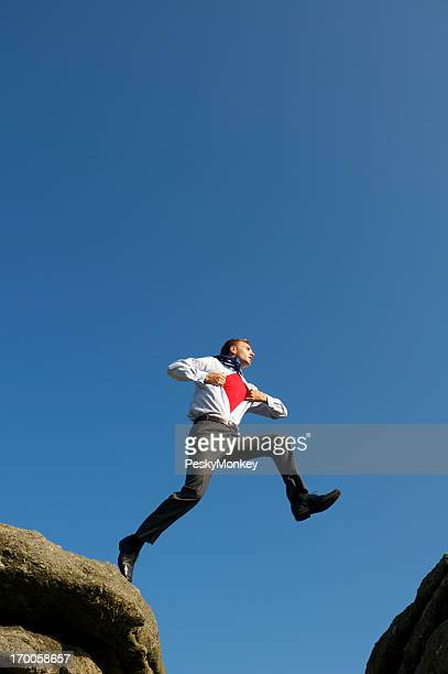 Businessman Superhero Leaps Across Valley
