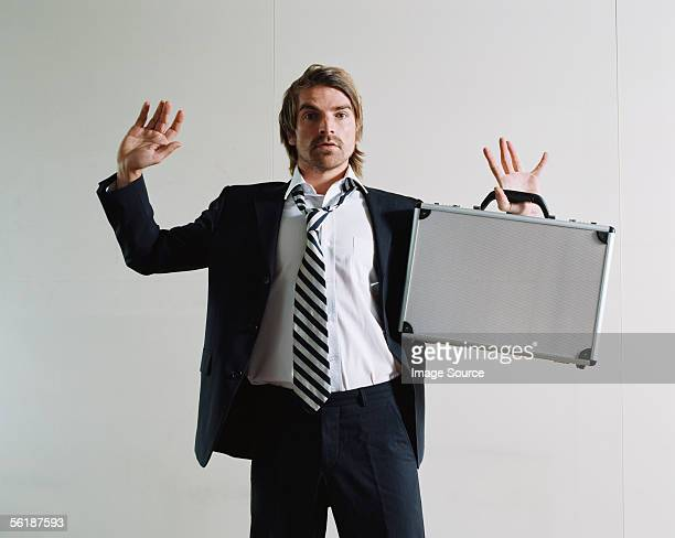 Businessman surrendering