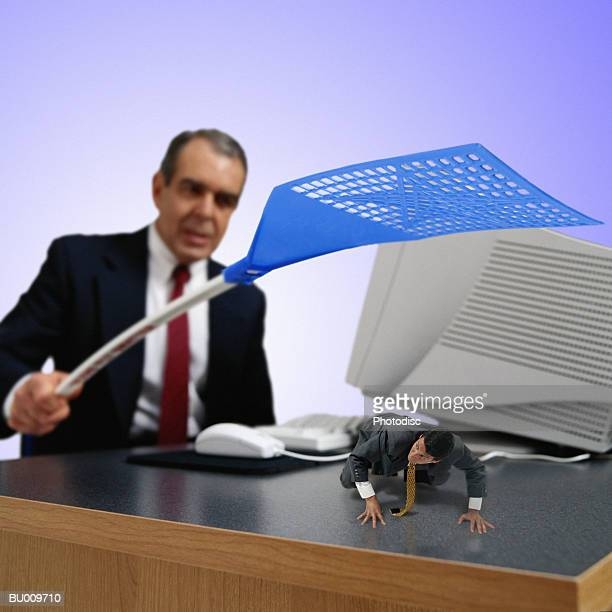 Businessman Swatting Businessman