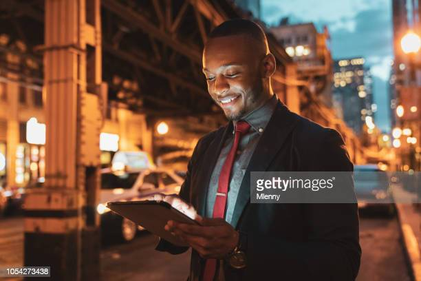 Businessman Tablet Computer in Chicago Streets at Night