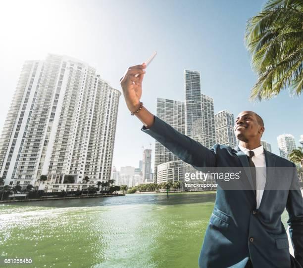 businessman take a selfie in miami brickell