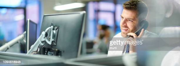 businessman taking a call - stock trader stock pictures, royalty-free photos & images