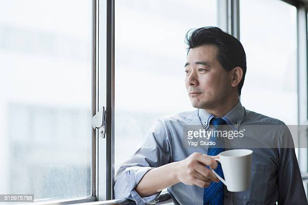 Businessman taking a coffee break in office
