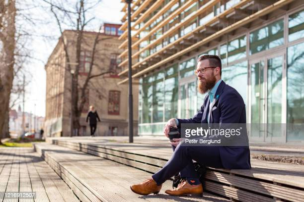 businessman taking a coffee break - gothenburg stock pictures, royalty-free photos & images