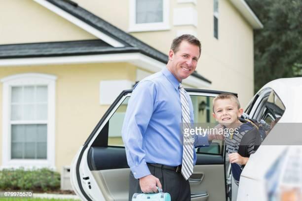 Businessman taking boy to school by car