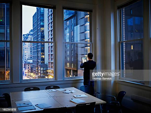 Businessman taking digital photo of cityscape