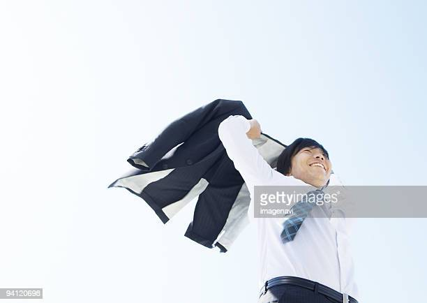 Businessman taking off his jacket