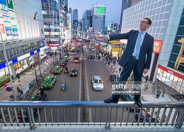 businessman taking selfie balancing on a handrail. - hazard stock pictures, royalty-free photos & images