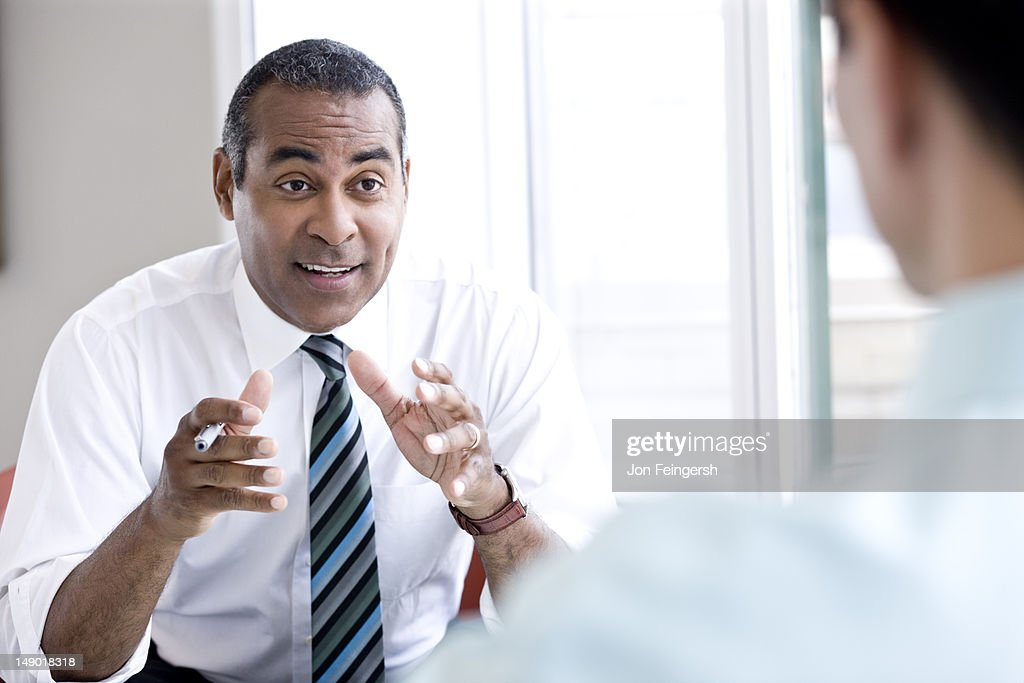 Businessman talking and gesturing : Stock Photo