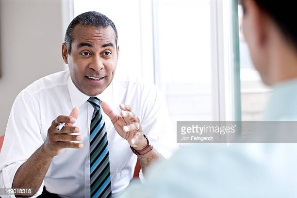 Businessman talking and gesturing
