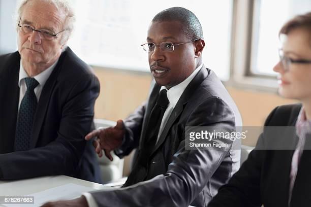 Businessman talking during presentation in office