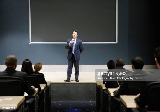 Businessman talking in auditorium