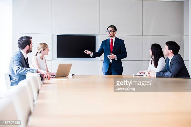 Businessman talking in business meeting