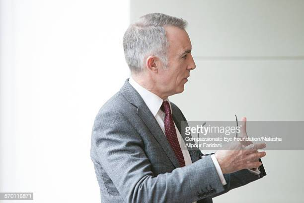 Businessman talking in meeting in conference room