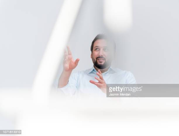 businessman talking in office - gesturing stock pictures, royalty-free photos & images