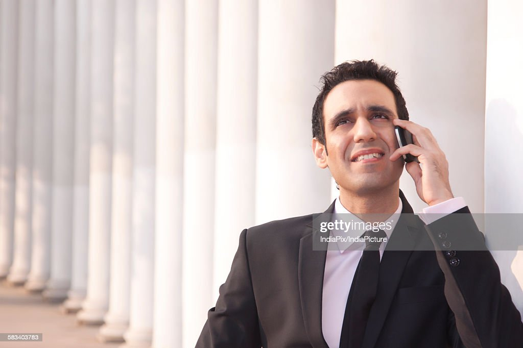 Businessman talking on a mobile phone  , INDIA , DELHI : Stock Photo
