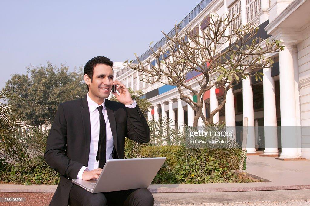 Businessman talking on a mobile phone , INDIA , DELHI : Stock Photo