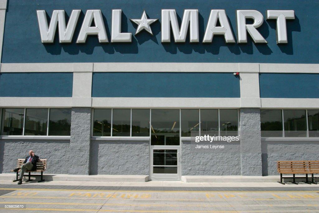 Walmart Stock Phone Number >> Businessman Talking On Cell Phone Outside Walmart Stock Photo